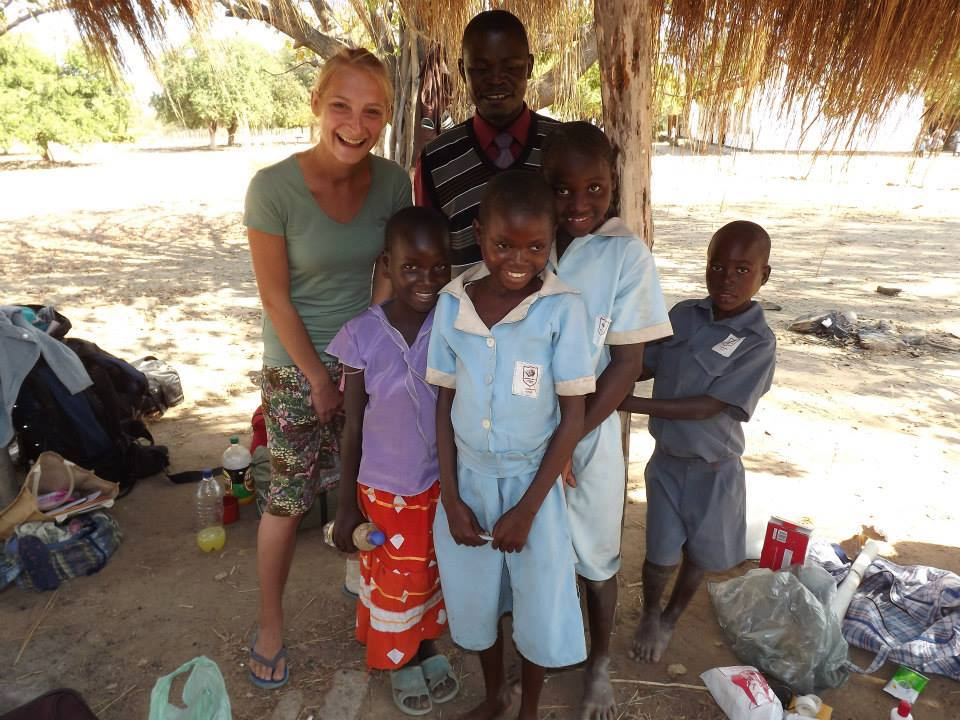 Me with Venoria, Assurance, and Vheremu who are already being sponsored by us in one school, the deputy head, and one inquisitive boy who just came to say hi!